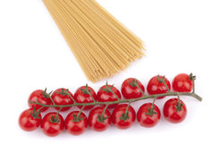 Red cherry tomatoes and noodles. Royalty Free Stock Photos