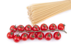 Red cherry tomatoes and noodles. Stock Photos