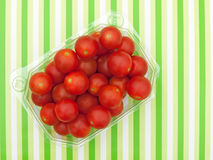 Red cherry tomatoes in plastic container Royalty Free Stock Photo