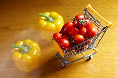 Red cherry tomatoes in shopping cart Stock Image