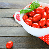 Red cherry tomatoes in a tureen Royalty Free Stock Images
