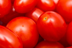 Red Cherry Tomatoes In Vegetable Market Stock Photo