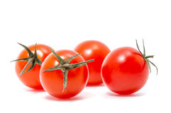 Red cherry tomatoes. On white background Royalty Free Stock Photography