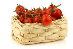 Red cherry tomatoes in a woven basket Royalty Free Stock Photo