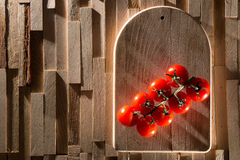 Red cherry tomatos on wood plate Stock Photos
