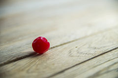 Red cherry on wooden floor Royalty Free Stock Photography