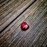 Red Cherry on Wooden Surface Stock Photo