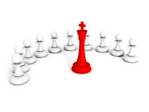 Red chess king leader of pawns team Stock Image