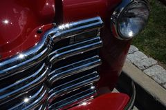 1953 red chevroelet pickup truck, front grill. Headlight and portion of bumper, vintage, fully restored Stock Photo