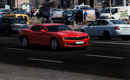 Red Chevrolet Camaro in city Stock Images