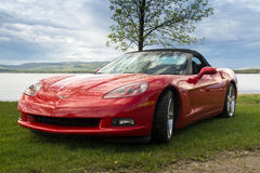 Red Chevrolet Corvette 2005 car. Red sport Chevrolet Corvette 2005 car in front of a lake, Qc, Canada Royalty Free Stock Photography