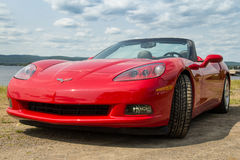 Red Chevrolet Corvette 2005 car. St-Gabriel-de-Brandon, Сanaday- July 18, 2014: Chevrolet Corvette 2005 red sport car on cloudy day in front of lake and Stock Photo