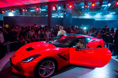 Red Chevrolet corvette at delhi Auto Expo 2016. DELHI, INDIA 6TH FEB 2016: Visitors look at the red Chevrolet Corvette at the Delhi Auto Expo 2016. The chevy Royalty Free Stock Images
