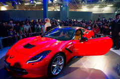 Red Chevrolet corvette at delhi Auto Expo 2016. DELHI, INDIA 6TH FEB 2016: Visitors look at the red Chevrolet Corvette at the Delhi Auto Expo 2016. The chevy Stock Image