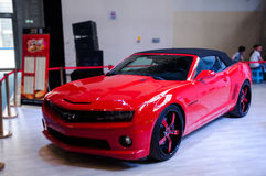 A red Chevy car. Take on the 16th Chongqing International Motor Show, June 6th-12th, 2014. There are many international famous brand companies and corporations Stock Images