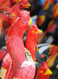 Red chicken. Closeup head of red chicken stone statue royalty free stock photo