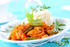 Red chicken curry stripes with rice Stock Photo