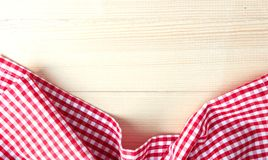 Red checkered cloth on wooden background up view. Stock Photos