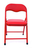 Red child's chair on white. Isolated: red child's chair on white background Royalty Free Stock Images