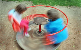 Red children carousel spinning round Stock Image