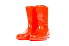 Red children rain boots. On a white background stock photography