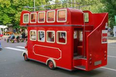 Red children`s bus in the British style royalty free stock photos