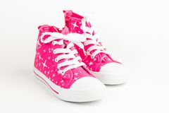 Red children& x27;s shoes. On white background. stock images