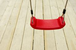 Red children's swing Royalty Free Stock Photography