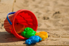 Red childrens bucket and moulds Stock Image