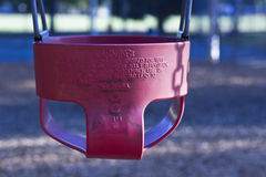 A red childs swing Stock Photos