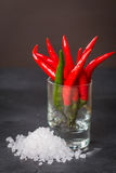Red chile pepper  in glass Stock Photo