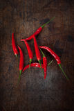 Red chili. Fresh red chili on wood table Stock Photography
