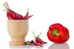 Red chili and bell pepper on wooden Royalty Free Stock Photos