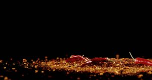 Red chili falling on chili flakes 4k stock footage