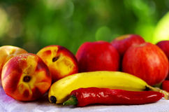 Red chili and fruits on table Royalty Free Stock Image