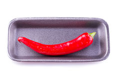 Red chili. On a gray substrate on a white background. can be used for display in a shop window Stock Image