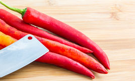 Red chili. Red hot chili pepper and knife on wooden cutting board Royalty Free Stock Photography