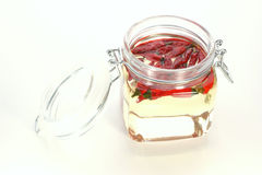 red chili in a jar with oil Royalty Free Stock Photo