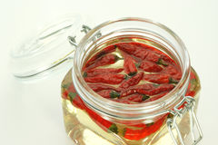 red chili in a jar with oil Stock Image