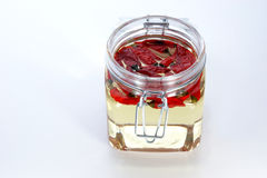 red chili in a jar with oil Stock Photo