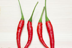 Red chili on the light brown wooden Stock Photography