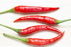 Red chili on the light brown wooden Royalty Free Stock Image