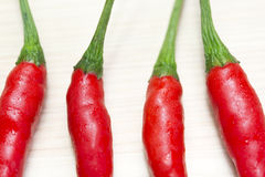 Red chili on the light brown wooden Royalty Free Stock Photography