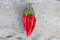 Red chili on old wood. Fresh four red chili on old wood stock photo