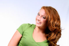Red Chili Pepper. Beautiful girl with fabulous red hair and perfect teeth Stock Image