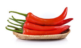 Red chili pepper in the basket isolated on white background Royalty Free Stock Photo