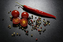 Red chili pepper and cherry tomatoes Stock Image