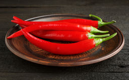 Red chili pepper in a clay dish Royalty Free Stock Photography