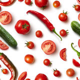 Red chili pepper, cucumber and tomato on white background . stock photography