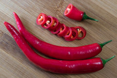 Red chili pepper cutting slieces. On bamboo board stock photography